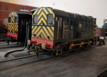 A pair of 08's share the fuelling point on the depot.